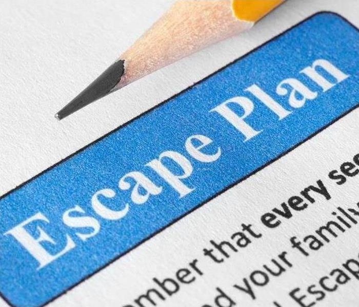 Paper that says escape plan and there is a pencil